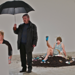 LABOUR Exhibition.2012 Cummins performs in the VOID gallery, Derry. 8 hour performance with Irish women artists from north and south of Ireland. (Cummins holding umbrella).Curated by Chrissie Cadman.